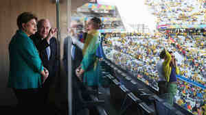 Brazilian President Dilma Rousseff and FIFA President Sepp Blatter talk prior to Thursday's World Cup match between Brazil and Croatia at Arena de Sao Paulo in Sao Paulo, Brazil.