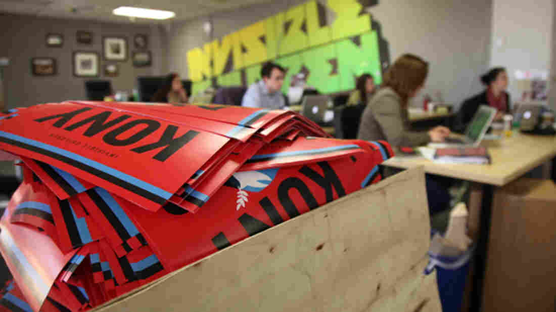 """A box brims with """"Kony 2012"""" posters at Invisible Children offices in March 2012. The group had to increase staff after the success of the film, but now it has a budget problem."""