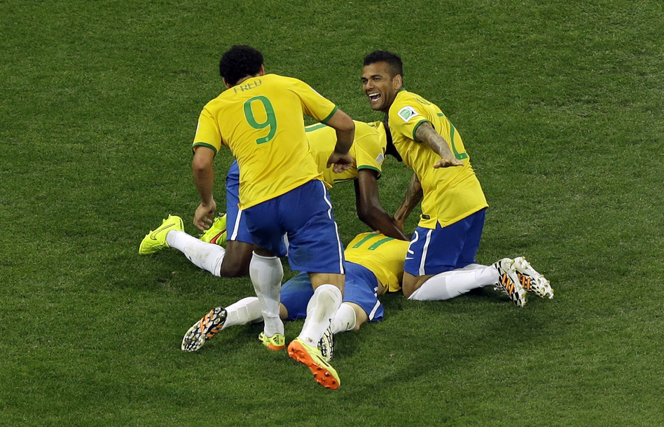 Members of Brazil's national team celebrate after scoring their third goal during the group A World Cup soccer match between Brazil and Croatia on Thursday. (Thanassis Stavrakis/AP)