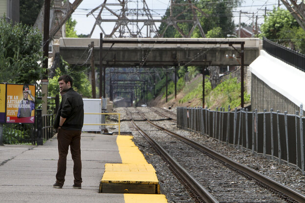 Unaware of the work stoppage Roy Pearson waits for a SEPTA commuter train at the East Falls commuter rail station in