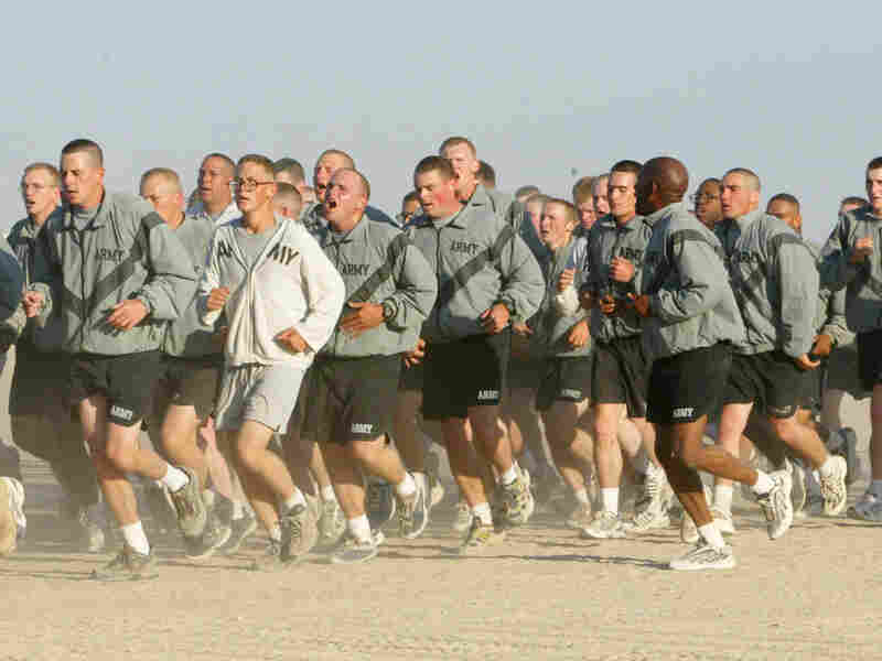 U.S. Army soldiers take part in a morning run at Camp New York, Kuwait in 2002.