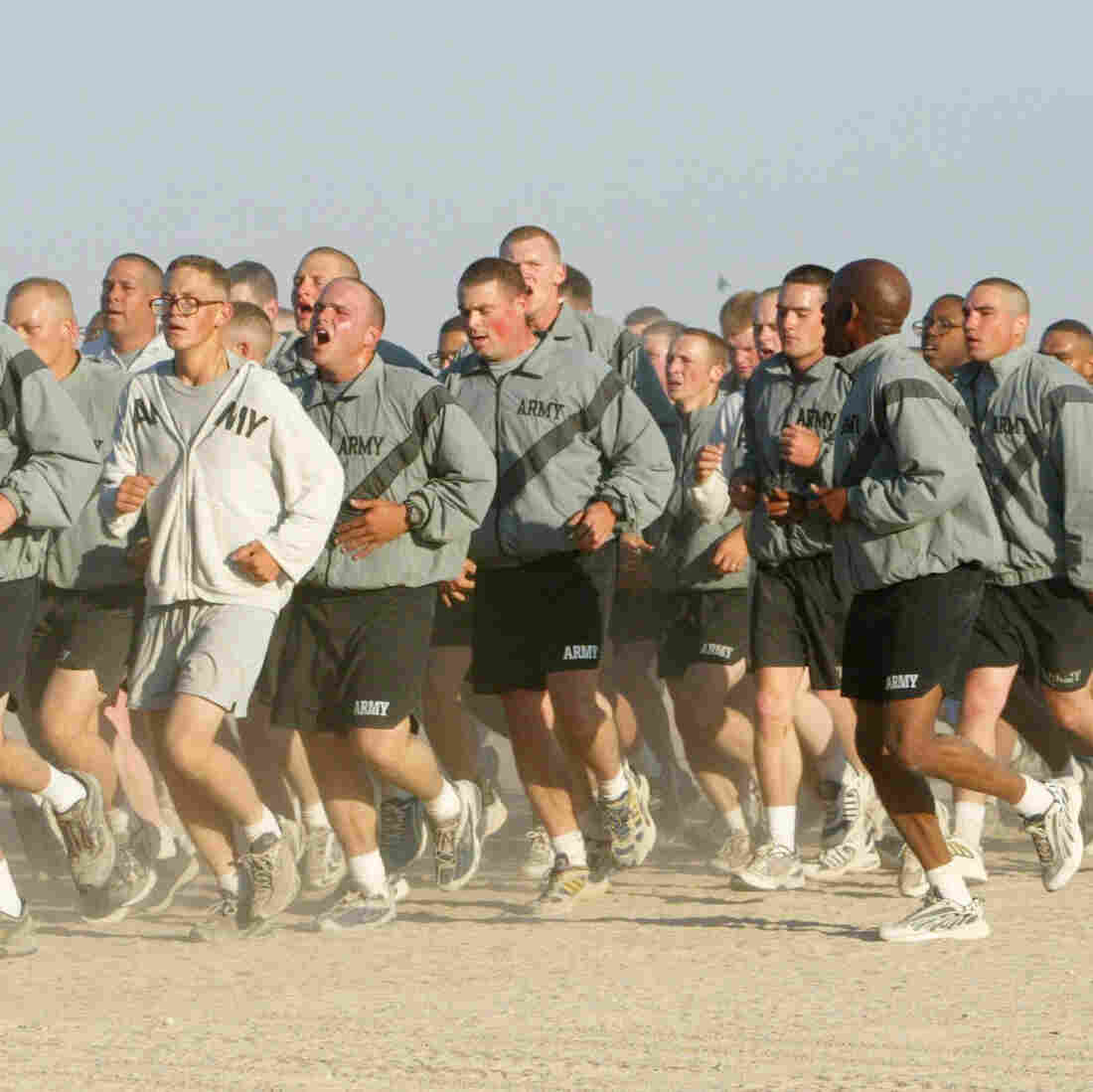 U.S. Army soldiers take part in a morning run at Camp New York, Kuwait, in 2002.