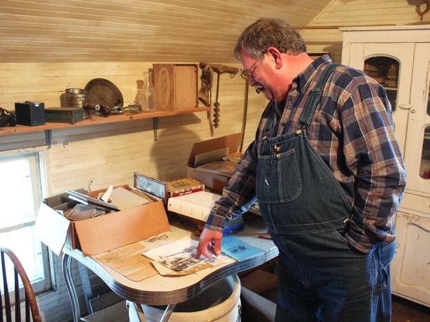 Donn Teske looks through family heirlooms in a house where his ancestors lived near Wheaton, Kans.