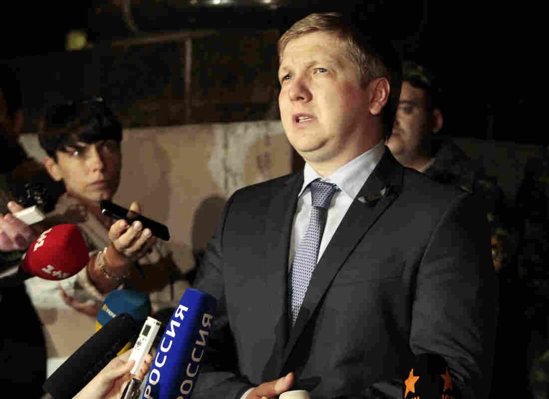 Naftogaz Chairman Andrew Kobolev speaks to reporters Monday outside the government building in Kiev, Ukraine.