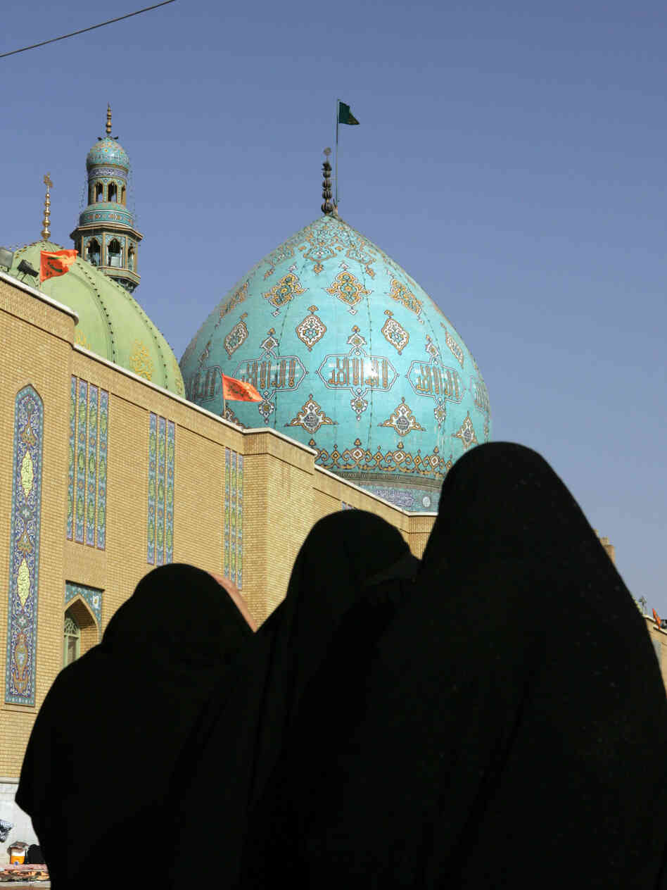 Women walk in the courtyard of the Jamkaran mosque outside the holy city of Qom, Iran, in 2