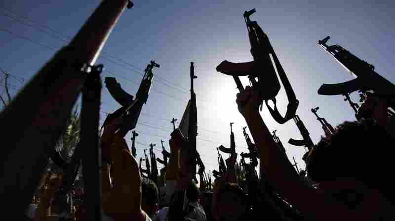 Iraqi Shiite tribesmen show their enthusiasm Tuesday for joining Iraqi security forces in the fight against Islamist militants who have taken over several northern Iraqi cities.