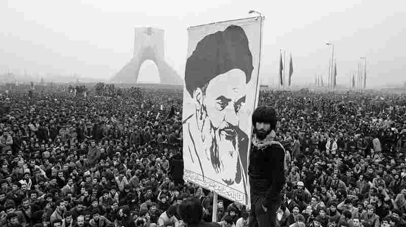 Demonstrators hold up a poster of exiled Shiite Muslim leader Ayatollah Khomeini during an anti-shah demonstration in Tehran, the Iranian capital, on Dec. 10, 1978. The Iranian revolution in 1979 had a powerful effect on the wider Muslim world, particularly among Shiites.