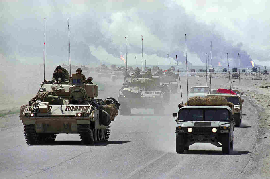 Vehicles of the U.S. Army's 3rd Armored Division move north through Kuwait on March 31, 1991, during the Gulf War, which ousted Saddam Hussein's forces from its neighbor.