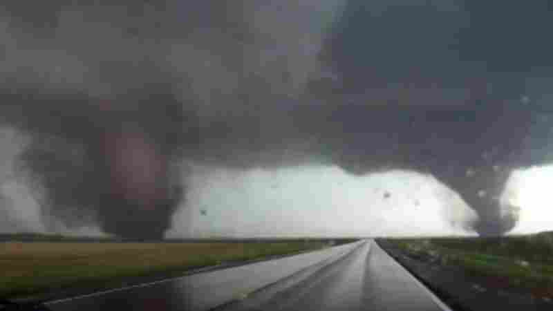 A still image from a video shows two tornadoes approaching Pilger, Neb., Monday. The National Weather Service said at least two people died in the large storm that hit northeast Nebraska.