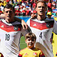 German soccer players sing their national anthem Monday before their 2014 World Cup match against Portugal in Salvador, Brazil.