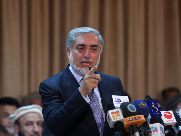 Afghan presidential candidate Abdullah Abdullah speaks during a news conference in Kabul, Afghanistan, on Sunday. Abdullah has accused his opponent of election fraud.