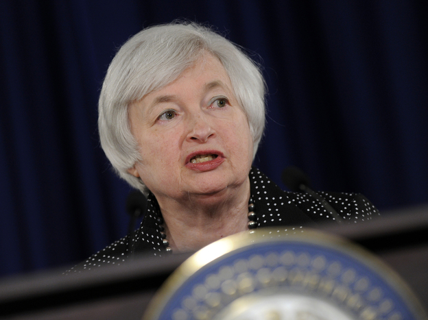 Federal Reserve Chair Janet Yellen speaks during a news conference at the Federal Reserve in Washington, on Wednesday. The Fed announced that it was cutting back on bond buying and would leave short-term rates unchanged.