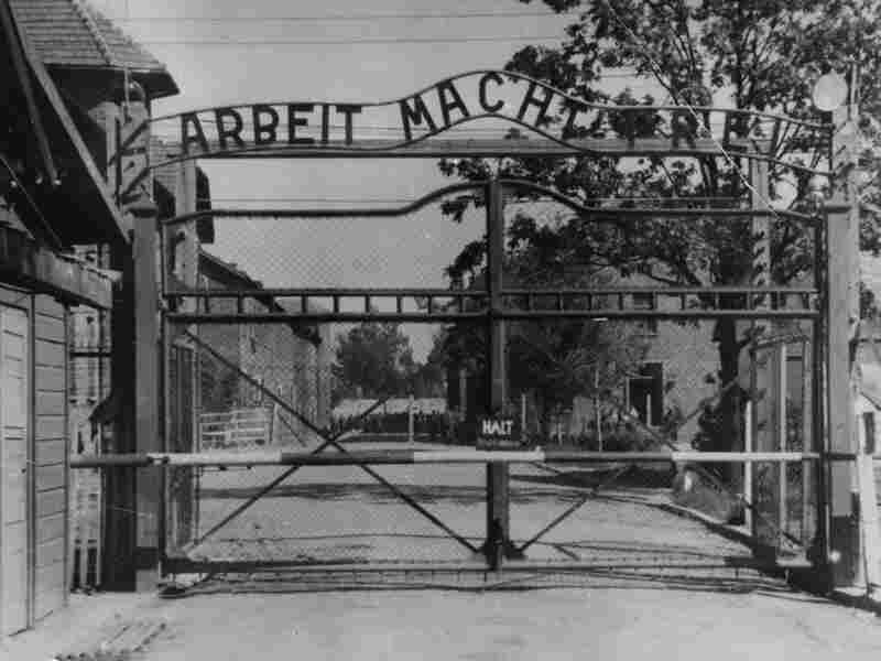 "The Nazi concentration camp Auschwitz I in Poland, circa 1945. Writing over the gate reads ""Arbeit macht frei"" (Work Sets You Free). Johann Breyer has admitted to working as a guard at the camp but says he only supervised work parties outside the gates."