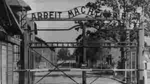 """The Nazi concentration camp Auschwitz I in Poland, circa 1945. Writing over the gate reads """"Arbeit macht frei"""" (Work Sets You Free). Johann Breyer has admitted to working as a guard at the camp but says he only supervised work parties outside the gates."""