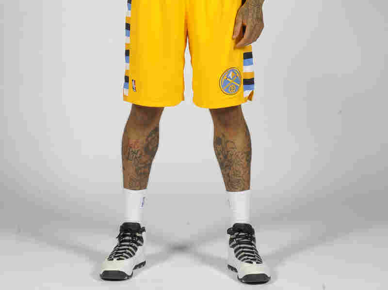 Wilson Chandler of the Denver Nuggets has cartoons all over his legs.