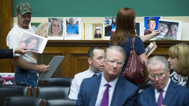 Family members of victims of a faulty GM ignition switch lined the rear wall of a congressional hearing with their photos Wednesday.
