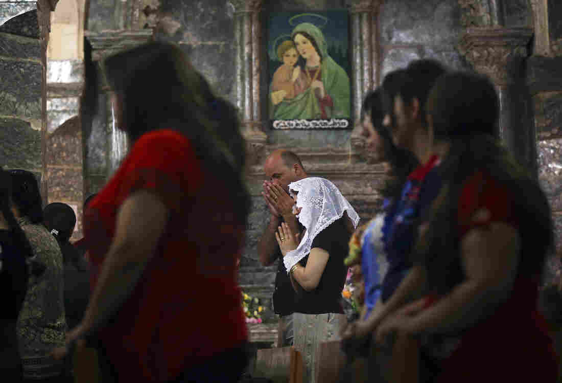 Iraqis attend Mass at the Chaldean Church of the Virgin Mary of the Harvest, in Al-Qosh on June 15. Both Christians and Muslims fleeing the ISIS takeover of Mosul in northern Iraq have taken refuge in Al-Qosh, an ancient Christian village.
