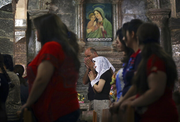 Iraqis attend Mass at the Chaldean Church of the Virgin Mary of the Harvest, in Al-Qosh on June 15. Both Christians and Muslims fleeing the ISIS takeover of Mosul in northern Iraq have taken refuge in Al-Qosh, an ancient