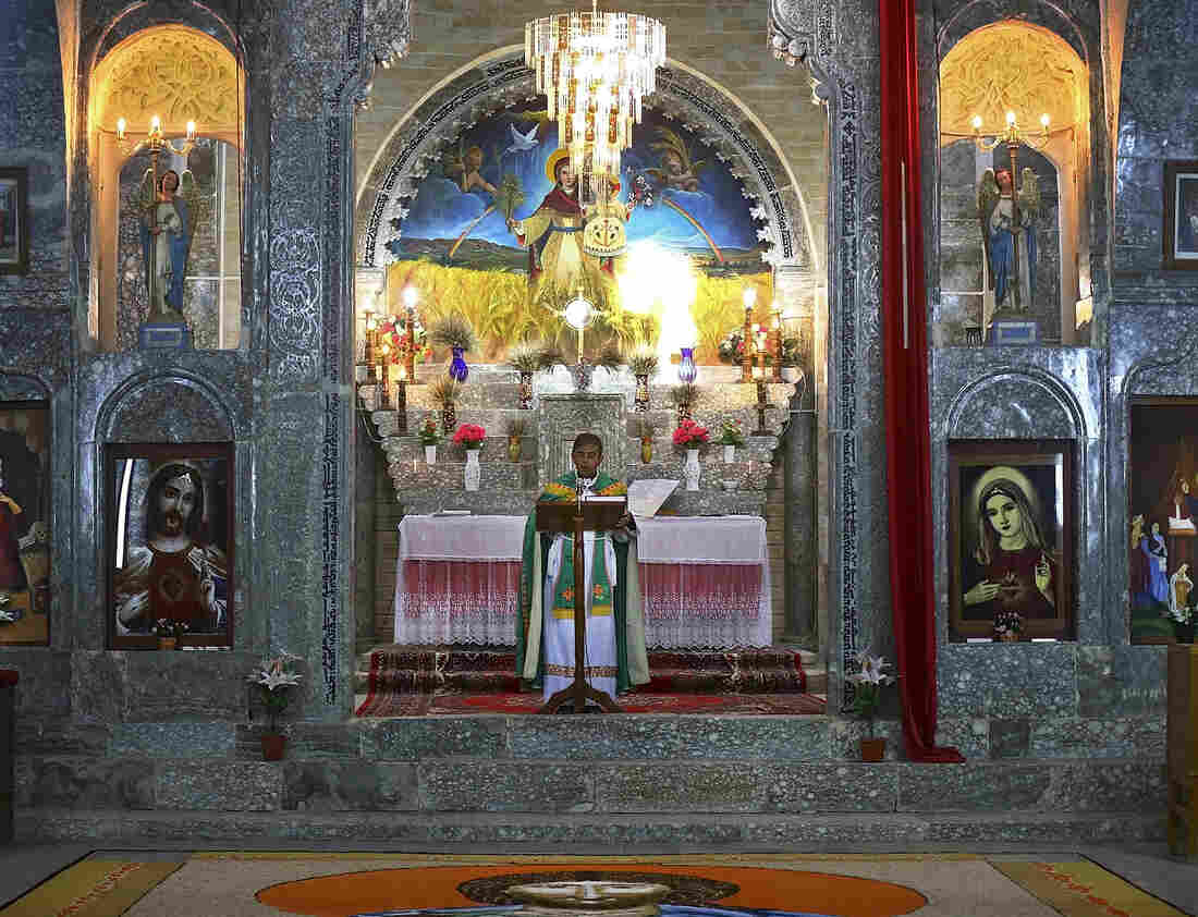 Friar Gabriel Tooma leads Mass at the Chaldean Church of the Virgin Mary of the Harvest, in Al-Qosh on June 15.