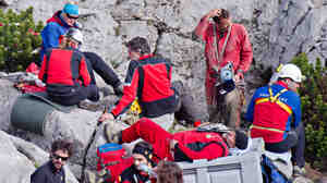 Rescuers near the entrance to the Riesending cave at Untersberg mountain near Marktschellenberg, Germany, on Thursday. A seriously injured cave researcher was hauled out after spending two weeks underground.