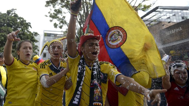 Colombian fans celebrate after their team's 3-0 victory over Greece in the opening rounds of the 2014 Wor