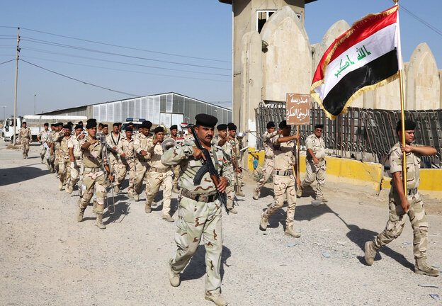 Iraqi army soldiers parade during a recruiting drive for men to volunteer for military service in Baghdad on Thursday. The country's leaders are urging Iraqis to help battle insurgents who have mounted an aggressive campaign in the north.