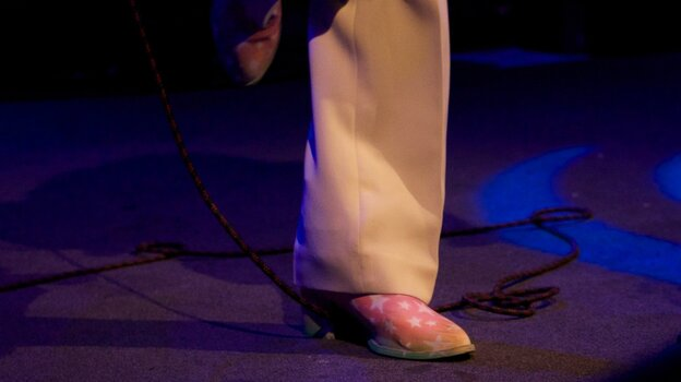 Which musician wears these custom-decorated shoes on stage these days?