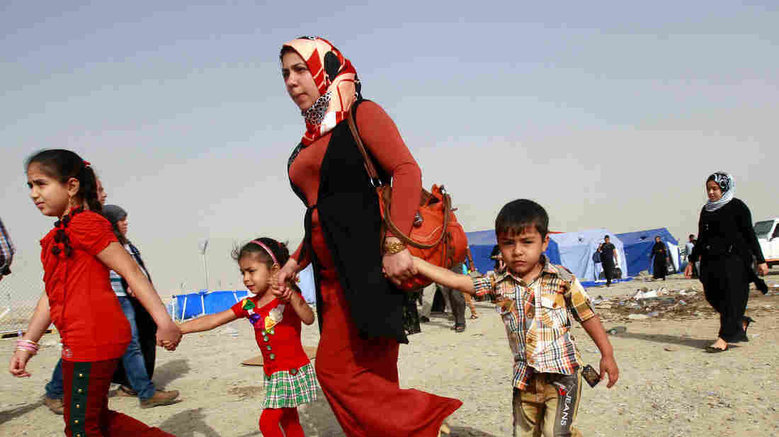 This family is among the hundreds of thousands of Iraqis who have fled the northern city of Mosul after Sunni militants captured the city last week. Many have gone to the nearby Kurdish region, which has remained largely peaceful.