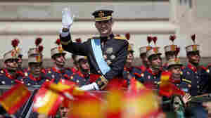 King Felipe VI greets well-wishers as he arrives at the Royal Palace in Madrid for his coronation ceremony on Thursday. His father, the former King Juan Carlos, abdicated after a 39-year reign.