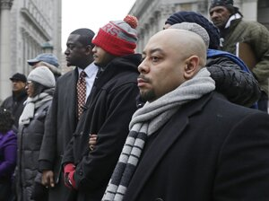 """Raymond Santana (right), Kevin Richardson and Yusef Salaamat attend a rally in Foley Square, New York City, in January 2013. The three men were among the """"Central Park Five,"""" who were con"""