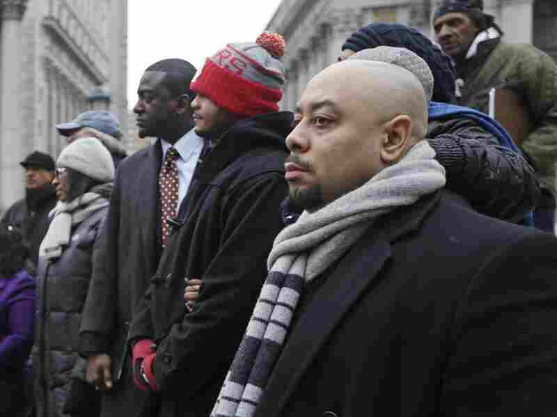 "Raymond Santana (right), Kevin Richardson and Yusef Salaamat attend a rally in Foley Square, New York City, in January 2013. The three men were among the ""Central Park Five,"" who were convicted of beating and raping a white woman but have since been exonerated."