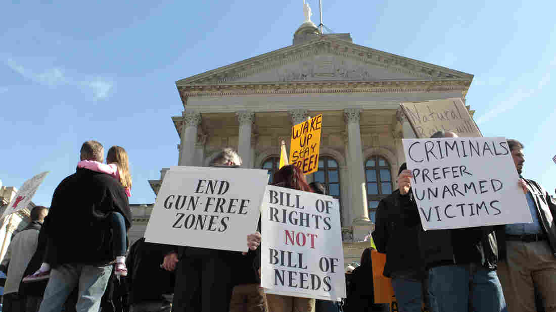Protesters participate in the Guns Across America rally at the state capitol in Atlanta in 2013. The Safe Carry Protection Act goes into effect on July 1, but it's already creating confusion for many Georgia residents.