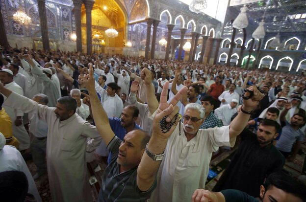 """Iraqi Shiites perform the Friday prayer in the shrine city of Karbala in central Iraq. Iraq's top Shiite cleric, Grand Ayatollah Ali al-Sistani, called for the country's next government to be """"effective"""" and avoid past mistakes, in an implicit criticism of Prime Minister Nouri al-Maliki."""