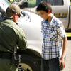 Romero is detained at a county park near McAllen, Texas, after wading across the Rio Grande. He says he left Central America to avoid conscription by street gangs and to join his family in the U.S.