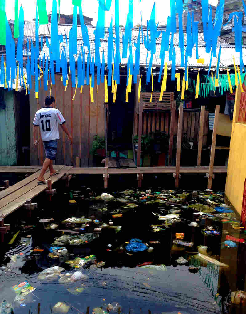 Educandos, a neighborhood in Manaus, Brazil, sits on planks above flood waters filled with garbage and pollution.