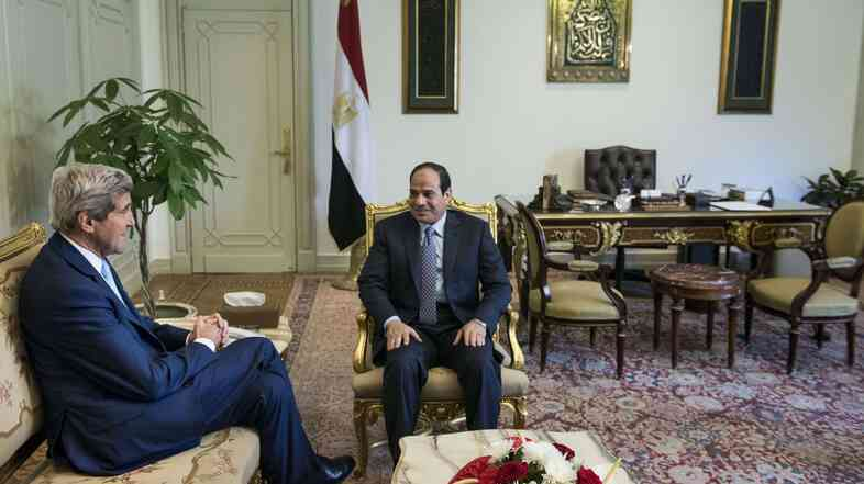 Egyptian President Abdel-Fattah el-Sissi and U.S. Secretary of State John Kerry talk before a meeting at the Presidential Palace on Sunday in Cairo.
