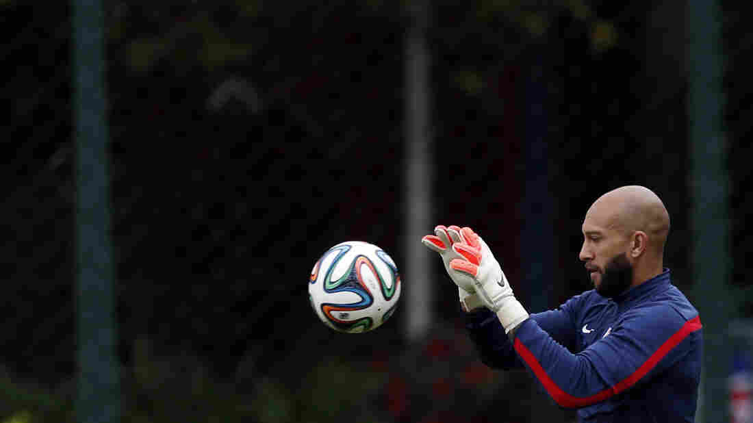 "United States' goalkeeper Tim Howard works out during a training session. ""We're going to do our best to bottle him up,"" Howard said of Portugal's forward Cristiano Ronaldo."