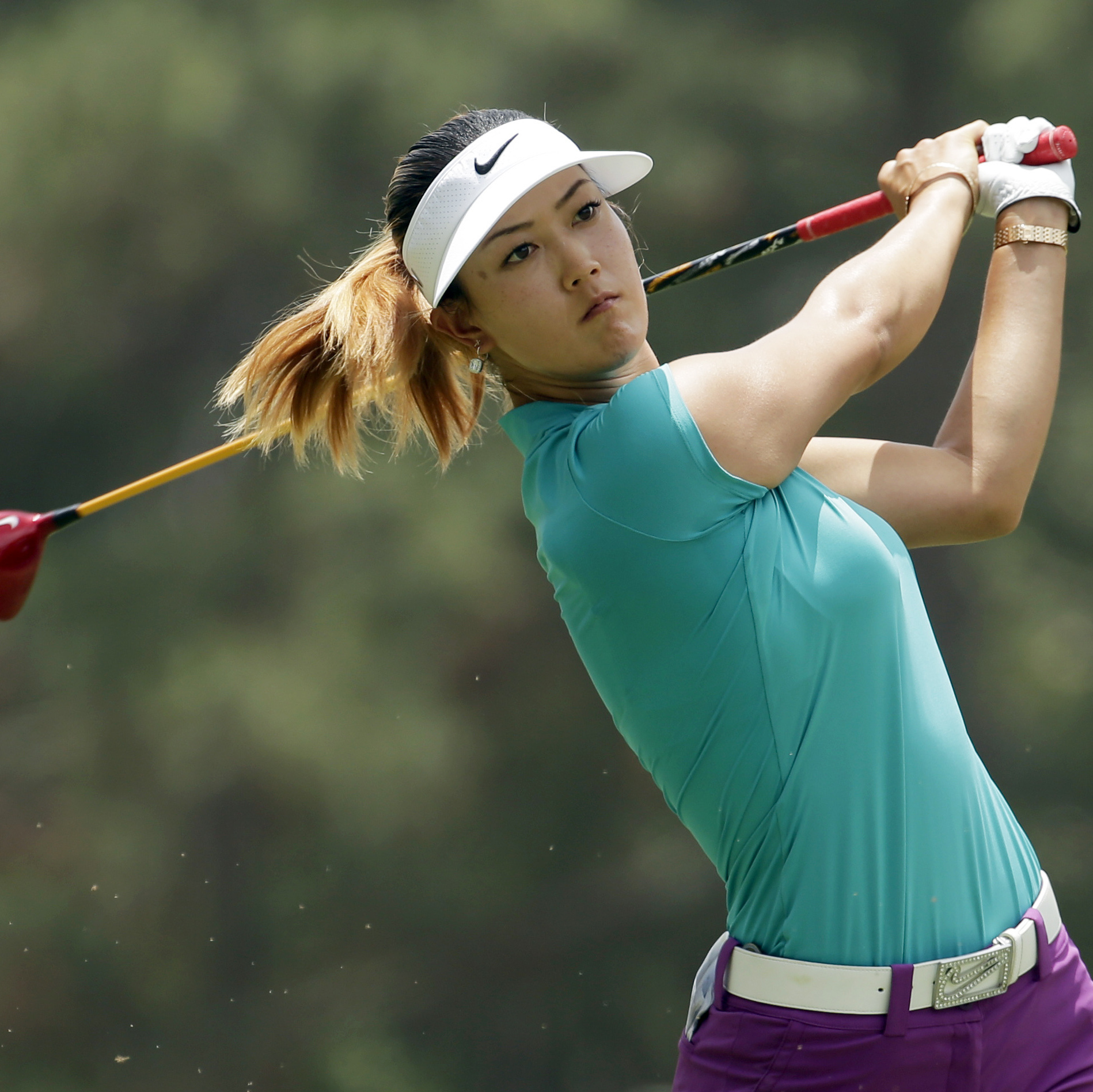promo code f4a67 cf3e7 ... Michelle Wie watches her tee shot on the second hole during the final  round of the ...