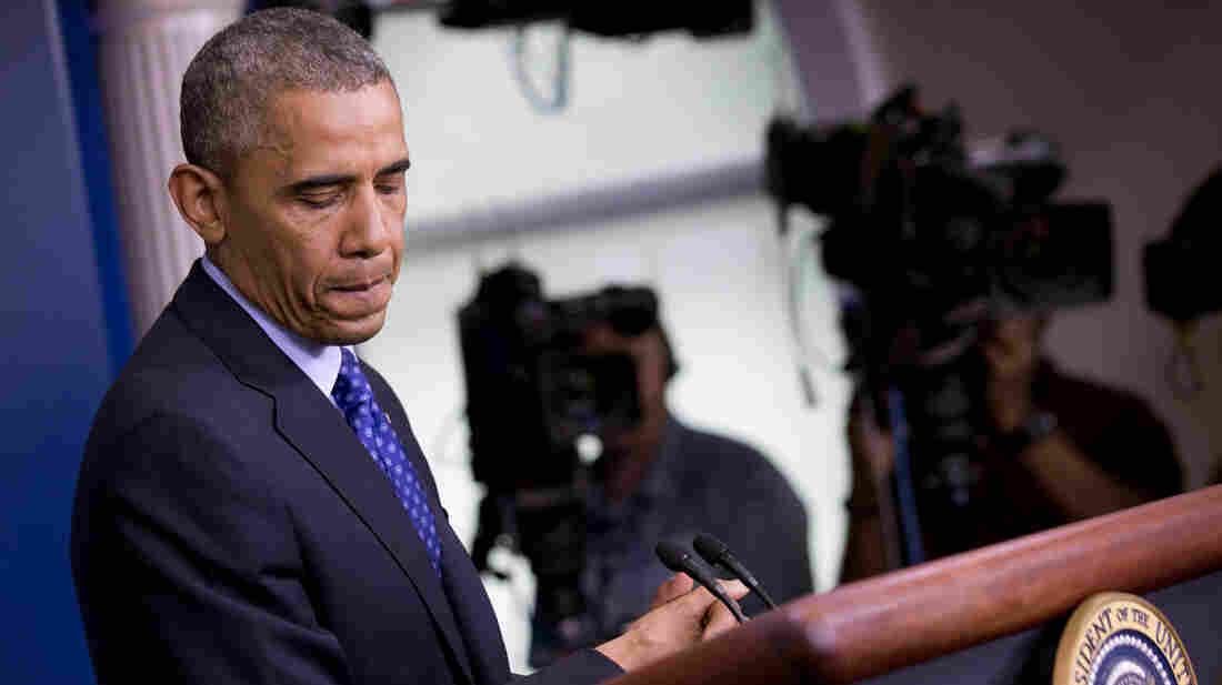 President Obama pauses while speaking about the situation in Iraq on Thursday. Obama said the U.S. will send up to 300 military advisers to Iraq and set up joint operation centers.