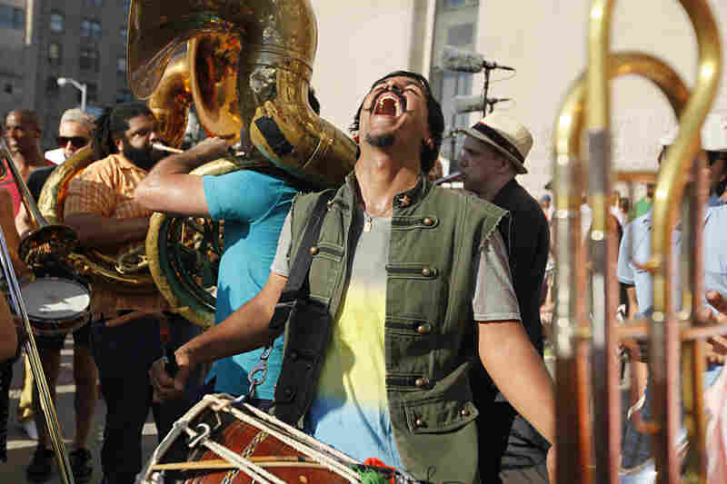 All around during the rehearsal and performance, musicians grin blissfully — including dhol player Sunny Jain, the work's composer.