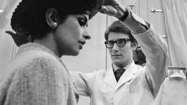 Yves Saint Laurent works with a model at his Paris fashion house in 1965. A new film follows the designer'
