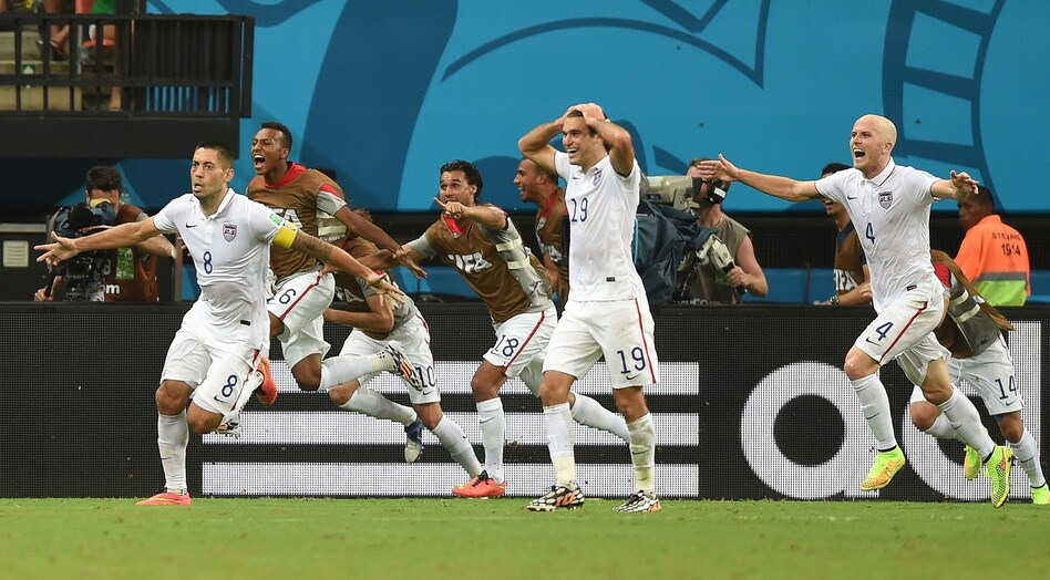 U.S. forward Clint Dempsey (8) celebrates after scoring his team's second goal during a match against Portugal at the Amazonia Arena in Manaus on Sunday. (Francisco Leong /AFP/Getty Images)