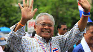 Suthep Thaugsuban waves to supporters during a mass rally in Bangkok, the same day the army declared martial law. Suthep says he act