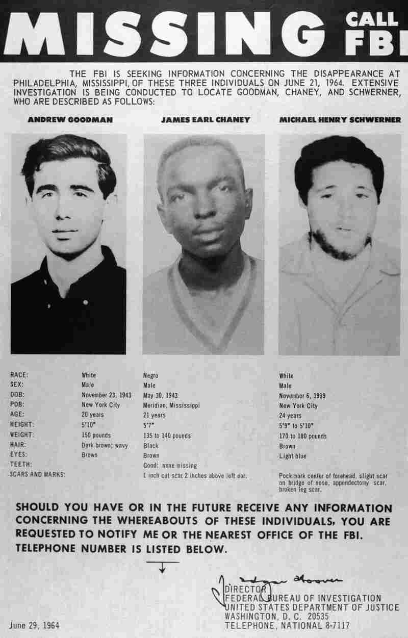 A missing persons poster displays the photographs of civil rights workers Andrew Goodman, James Chaney and Michael Schwerner after they disappeared in Mississippi. It was later discovered that they were murdered by the Ku Klux Klan.