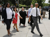 President Obama (aka the bear) walks to lunch at a Chipotle restaurant Monday.