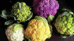 The Romanesco broccoli in the upper left corner is part of the brassica family, just like these colorful cauliflower varieties.