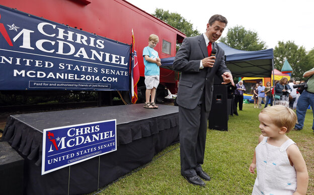 Polls give Chris McDaniel the advantage going into Tuesday's runoff for Mississippi's GOP Senate nomination. His 2-year-old son helped rally supporters in Madison, Miss., on Thursday.