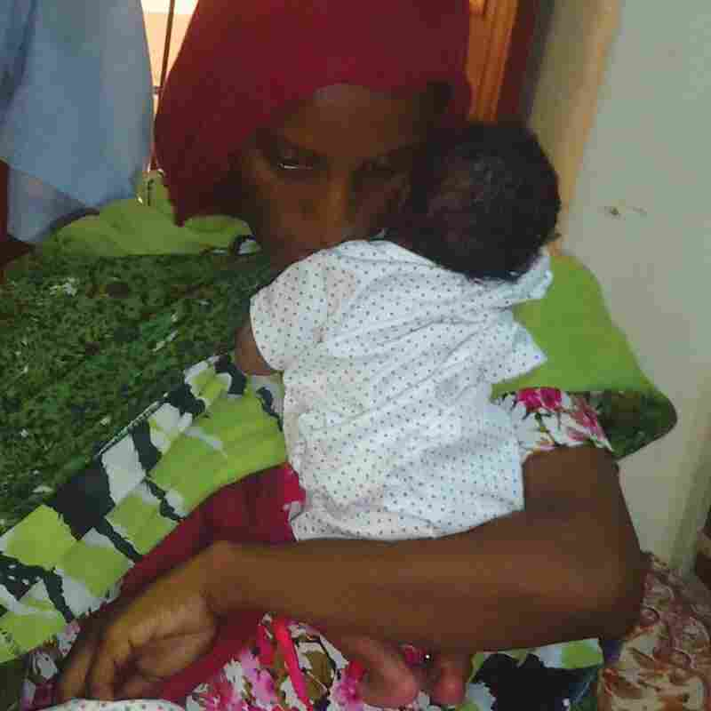 Meriam Yahia Ibrahim Ishag, a Christian Sudanese woman sentenced to death, sits in her cell with her baby girl a day after she gave birth at a women's prison in Khartoum's twin city of Omdurman last month. A court ordered Ishag freed Monday.