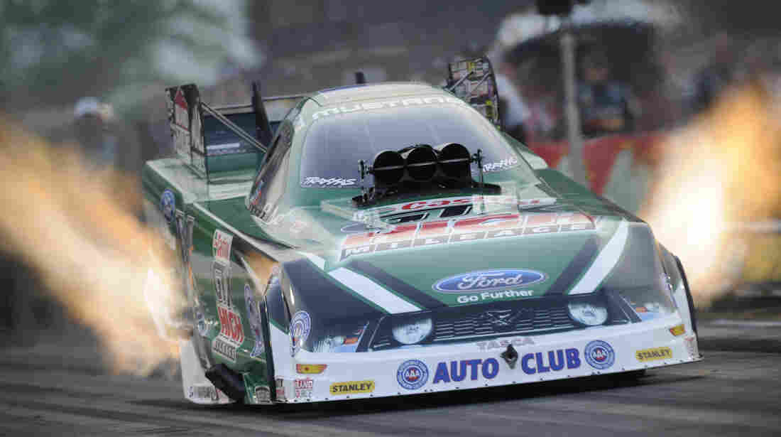 John Force launches from the starting line at the 2012 O'Reilly Auto Parts Route 66 National Hot Rod Association Nationals in Joliet, Ill.