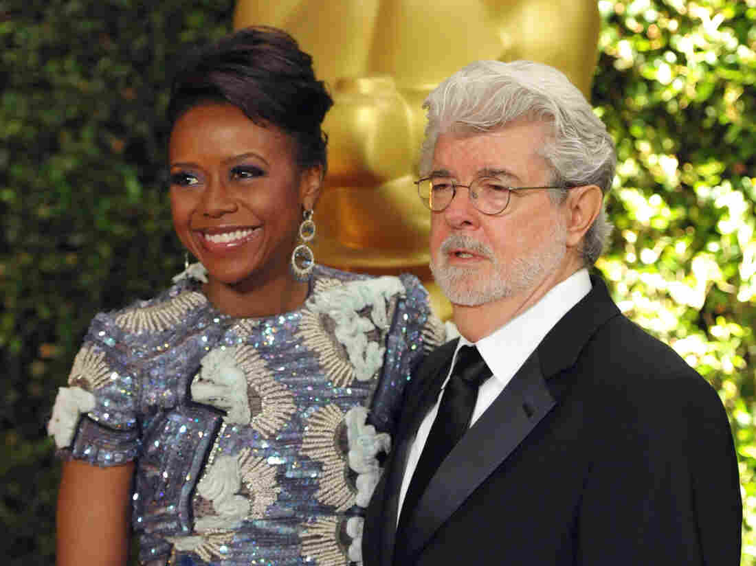 Filmmaker George Lucas and his wife, Chicago native Mellody Hobson, are seen on the red carpet at the 2013 Governors Awards in Los Angeles. Lucas has decided to locate his new museum in the Windy City.